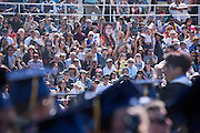 Friends and family cheer for their loved ones during the graduation ceremony at Milpitas High School in Milpitas, California, on June 6, 2015. (Stan Olszewski/SOSKIphoto)