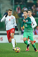 Wroclaw, Poland - 2016 November 14: (L) Thiago Cionek of Poland fights for the ball with (R) Andraz Sporar of Slovenia during Poland v Slovenia - International Friendly Soccer Match at Municipal Stadium on November 14, 2016 in Wroclaw, Poland.<br /> <br /> Adam Nurkiewicz declares that he has no rights to the image of people at the photographs of his authorship.<br /> <br /> Picture also available in RAW (NEF) or TIFF format on special request.<br /> <br /> Any editorial, commercial or promotional use requires written permission from the author of image.<br /> <br /> Mandatory credit:<br /> Photo by © Adam Nurkiewicz / Mediasport