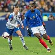 PARIS, FRANCE - March 25:  Paul Pogba #6 of France defended by Albert Gudmundsson #22 of Iceland during the France V Iceland, 2020 European Championship Qualifying, Group Stage at  Stade de France on March 25th 2019 in Paris, France (Photo by Tim Clayton/Corbis via Getty Images)