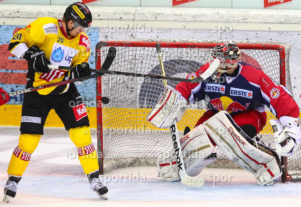 12.10.2012, Albert Schultz Eishalle, Wien, AUT, EBEL, UPC Vienna Capitals vs EC Red Bull Salzburg, 11. Runde, im Bild Marcus Olsson, (UPC Vienna Capitals, #20) und Alex Auld, (EC Red Bull Salzburg, #1)  // during the Erste Bank Icehockey League 11th Round match betweeen UPC Vienna Capitals and EC Red Bull Salzburg at the Albert Schultz Ice Arena, Vienna, Austria on 2012/10/12. EXPA Pictures © 2012, PhotoCredit: EXPA/ Thomas Haumer