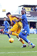 Tom Elliott of AFC Wimbledon battles Ryan Tafazolli of Mansfield Town during the Sky Bet League 2 match between AFC Wimbledon and Mansfield Town at the Cherry Red Records Stadium, Kingston, England on 16 January 2016. Photo by Stuart Butcher.