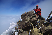 Alfredo Maiquez at the summit of north Illiniza 5.126 meters, Ecuador andes