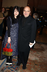 Film director ANTHONY MINGHELLA and his wife CAROLYN at the Conde Nast Traveller magazine Tsunami Appeal Dinner at the Four Seasons Hotel, Hamilton Place, London W1 on 2nd March 2005.<br />