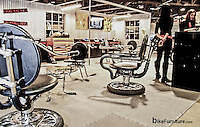 Chairs and table made from reused Harley Davidson motorcycle parts in the Harley Davidson Insurance booth at the Long Beach, CA stop of the International Motorcycle Show.