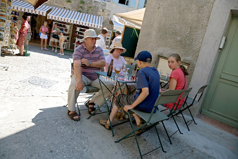 family taking a break of sight seeing at a popular tourist destination site France