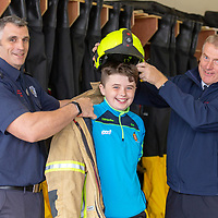 Ben Mulvihil from Shannon gets to sample the Fire Fighter uniform by Aaron Skerritt, Sub Officer of the Shannon Fire and Rescue Services, and Adrian Kelly, Chief Fire Offiicer
