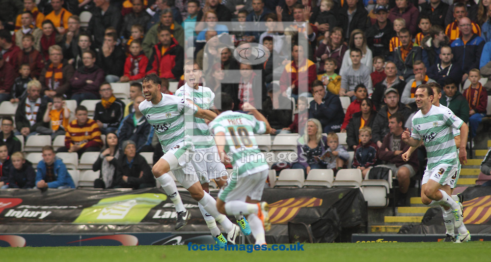Aaron Martin (L) of Yeovil Town celebrates scoring the his goal against Bradford City during the Sky Bet League 1 match at the Coral Windows Stadium, Bradford<br /> Picture by Stephen Gaunt/Focus Images Ltd +447904 833202<br /> 06/09/2014