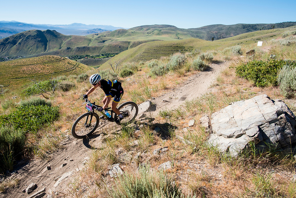 Amy Beisel descends the Ash to Kings trail with grand views of the surrounding mountains.
