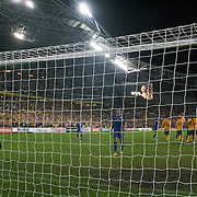 Harry Kewell scores from the penalty spot as he hits the ball past goalkeeper Ignatiy Nesterov  for Australia's second goal during the 2010 Fifa World Cup Asian Qualifying match between Australia and Uzbekistan at Stadium Australia in Sydney, Australia on April 01, 2009. Australia won the match 2-0.  Photo Tim Clayton