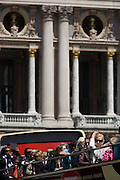 Tourists on the top deck opposite L'Opera during a city tour of Paris, France.