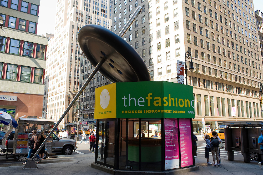 Fashion District / Garment District New York City..The Fashion Center information kiosk at 7th Avenue/Fashion Avenue. This unique structure incorporates the world's largest button appended to the structures roof, held upright by a 31-foot-long steel needle..More than a million New Yorkers pass through Midtown every day, but few know that the neighborhood between 34th and 40th Streets, and Broadway and Ninth Avenue, houses one of the largest manufacturing clusters in New York City. In the Garment District, hundreds of small factories and suppliers work closely with designers to create the latest styles that make New York City a global fashion capital, and influence the clothes we wear every day..photo © Stefan Falke