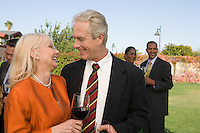 Couple drinking wine at outdoor party