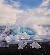 "Jökulsárlón (literally ""glacial river lagoon"") is a large glacial lagoon in southeast Iceland, on the borders of Vatnajökull National Park. Situated at the head of Breiðamerkurjökull, it evolved into a lagoon after the glacier started receding from the edge of the Atlantic Ocean."