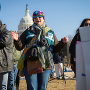 Carolyn Pryor, of Falls Church, hands out signs for demonstrators to hold during a protest and march from in front of the U.S. Capitol to the EPA, about the North Dakota Access Pipeline, as well as the effort to free Leonard Peltier.  Saturday, December 10, 2016.  Pryor is unable to go to North Dakota to participate in the Standing Rock protest of the Dakota Access Pipeline, so she actively engages in dialogue and demonstrations in and around DC.  John Boal Photography