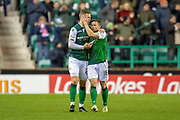 Florian Kamberi (#22) of Hibernian FC is congratulated by Lewis Stevenson (#16) of Hibernian FC after scoring the equalising goal during the Ladbrokes Scottish Premiership match between Hibernian and Rangers at Easter Road, Edinburgh, Scotland on 8 March 2019.