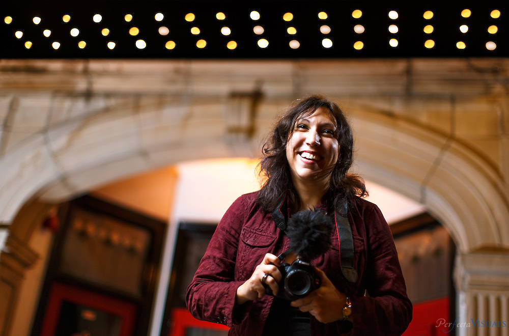 Olivia Mungal, an indie film director,  at the The Starr Theatre, Friday, November 6, 2015, in Greensboro, N.C.<br /> <br /> JERRY WOLFORD and SCOTT MUTHERSBAUGH / Perfecta Visuals<br /> <br /> <br /> She&rsquo;s a marketing manager on the weekdays. But on the weekend end she&rsquo;s Olivia Mungal, indie film director. <br /> &nbsp;<br /> The XX-year-old spends her Saturdays and Sundays filming short movies in and around Greensboro with her friends, who are also members of her production team.<br /> &nbsp;<br /> It&rsquo;s a hobby, and a passion.<br /> &nbsp;<br /> &ldquo;It is something that we have all kind of become addicted to and it&rsquo;s a growing passion for us,&rdquo; she says.<br /> &nbsp;<br /> Each year Olivia and her team participate in the 48-hour film festival, an international film festival competition where they are given 48 hours to write, film and edit a movie.