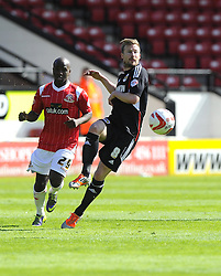 Bristol City's Wade Elliott battles for the ball with Walsall's Febian Brandy  - Photo mandatory by-line: Joe Meredith/JMP - Mobile: 07966 386802 12/04/2014 - SPORT - FOOTBALL - Walsall - Banks' Stadium - Walsall v Bristol City - Sky Bet League One