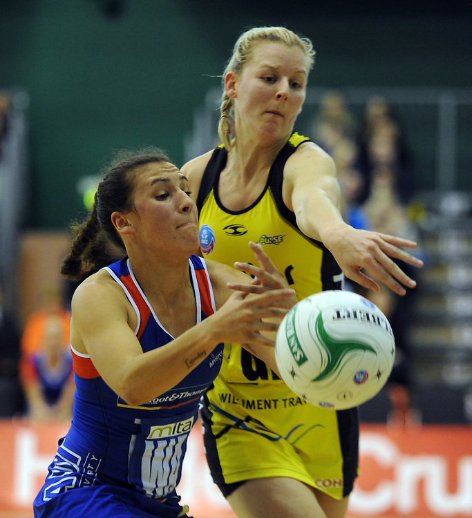 Mystics' Nadia Loveday, left and Pulse's Camilla Lees contest the ball in the ANZ Championship netball, Arena Manawatu, Palmerston North, New Zealand, Sunday, May 18, 2014. Credit:SNPA / Ross Setford