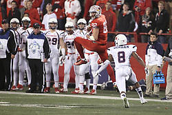 11 December 2015:  Anthony Warrum(82) makes a leaping reception before Jarriel Jordan can arrive. NCAA FCS Quarter Final Football Playoff game between Richmond Spiders and Illinois State Redbirds at Hancock Stadium in Normal IL (Photo by Alan Look)