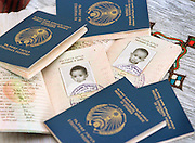 8/8/01 -- (PHOTO BY MIKE FENDER) w/ story, slug: AFRICA, file: 62040 // Beza, left, and Bayush, are pictured in their passport photos from a pile of the documents ready for their trip to America. Both of the young girls were headed for a new home in Bloomington.