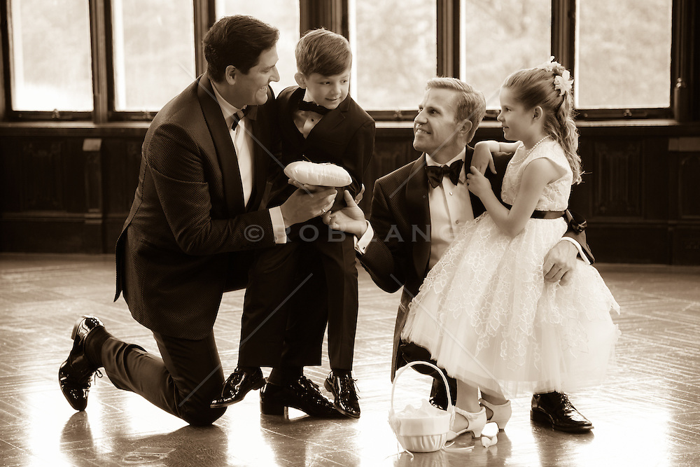 gay couple and their children at couple's wedding