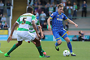 Dannie Bulman of AFC Wimbledon starts another attack during the Sky Bet League 2 match between Yeovil Town and AFC Wimbledon at Huish Park, Yeovil, England on 12 September 2015. Photo by Stuart Butcher.