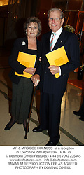 MR & MRS BOB HOLNESS  at a reception in London on 29th April 2004.PTR 79
