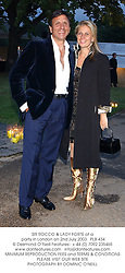 SIR ROCCO & LADY FORTE at a party in London on 2nd July 2003. PLB 434