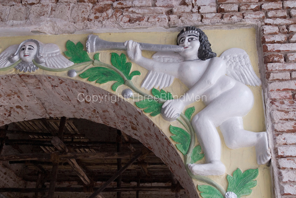 Detail from the Armenian Church in Chennai. The church was under restoration hence the uncovered brickwork. August 2007.