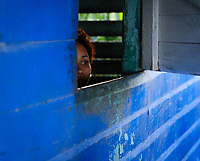 BARACOA, CUBA - CIRCA JANUARY 2020:  Cuban woman looking from a window at the Restaurant Tato in Manglito Beach, a popular beach close to Baracoa in Cuba.