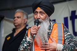 Southall, UK. 27th April 2019. A member of the local community addresses members of the local community and supporters at a rally outside Southall Town Hall to honour the memories of Gurdip Singh Chaggar and Blair Peach on the 40th anniversary of their deaths. Gurdip Singh Chaggar, a young Asian boy, was the victim of a racially motivated attack whilst Blair Peach, a teacher, was killed by the Metropolitan Police's Special Patrol Group during a peaceful march against a National Front demonstration.