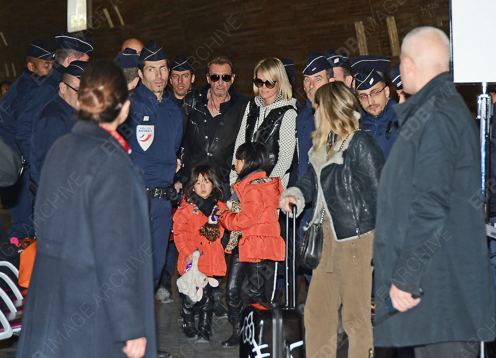 10.FEBRUARY.2013. PARIS<br /> <br /> JOHNNY HALLYDAY AND WIFE LAETICIA HALLYDAY ARRIVING AT CDG AIRPORT IN PARIS WITH DAUGHTERS JADE OODETTE DESIREE HALLYDAY AND JOY HALLYDAY FOR A FLIGHT BACK TO LOS ANGELES.<br /> <br /> BYLINE: EDBIMAGEARCHIVE.CO.UK<br /> <br /> *THIS IMAGE IS STRICTLY FOR UK NEWSPAPERS AND MAGAZINES ONLY*<br /> *FOR WORLD WIDE SALES AND WEB USE PLEASE CONTACT EDBIMAGEARCHIVE - 0208 954 5968*