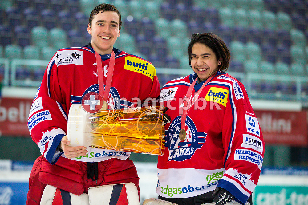(L-R) Rapperswil-Jona Lakers goaltenders Beat Trudel and Patrick Knoepfel pose for a photo with their gold medals and the Swiss Champion trophy after winning the fifth Elite B Playoff Final ice hockey game between Rapperswil-Jona Lakers and ZSC Lions held at the SGKB Arena in Rapperswil, Switzerland, Sunday, Mar. 19, 2017. (Photo by Patrick B. Kraemer / MAGICPBK)
