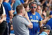 AFC Wimbledon fan with hands to mouth during the EFL Sky Bet League 1 match between AFC Wimbledon and Rotherham United at the Cherry Red Records Stadium, Kingston, England on 3 August 2019.