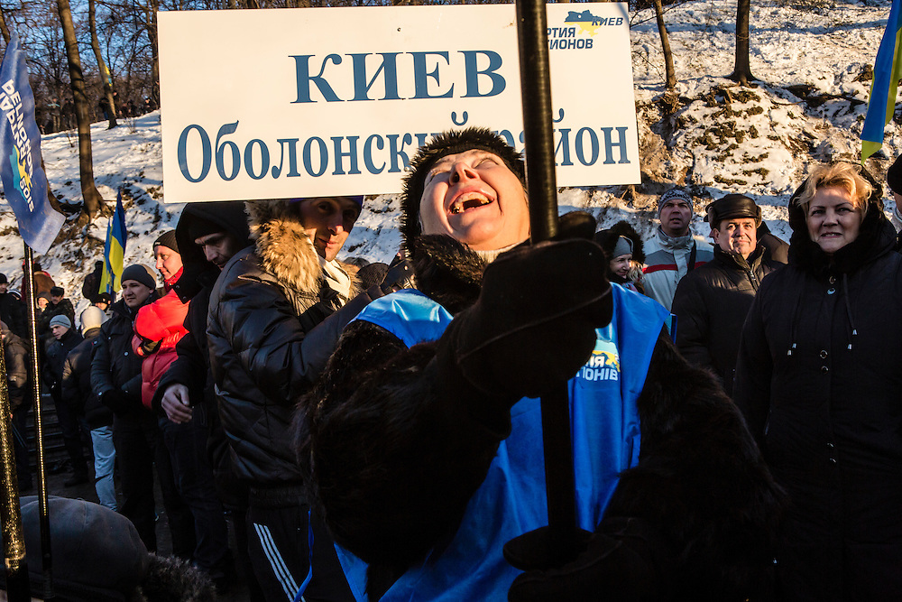 KIEV, UKRAINE - DECEMBER 14: A woman waves a flag at a pro-government rally held by Ukrainian President Viktor Yanukovych's ruling Party of Regions on December 14, 2013 in Kiev, Ukraine. Thousands of people have been protesting against the government since a decision by President Yanukovych to suspend a trade and partnership agreement with the European Union in favor of incentives from Russia. (Photo by Brendan Hoffman/Getty Images) *** Local Caption ***