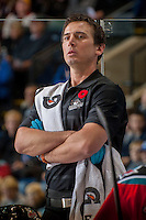 KELOWNA, CANADA - NOVEMBER 1:  Jeff Thorburn, athletic therapist of the Kelowna Rockets stands on the bench opposite the Kamloops Blazers at the Kelowna Rockets on November 1, 2012 at Prospera Place in Kelowna, British Columbia, Canada (Photo by Marissa Baecker/Shoot the Breeze) *** Local Caption ***