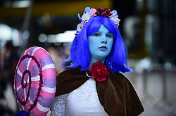 May 24, 2019, London, UK: A cosplayer attends the opening day of the bi-annual MCM Comic Con event at the Excel Centre in Docklands.  The event celebrates popular culture such as video, games, manga and anime providing many attendees with the opportunity to dress up as their favourite characters. (Credit Image: © Stephen Chung/London News Pictures via ZUMA Wire)