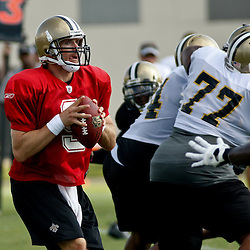 August 1, 2010; Metairie, LA, USA; New Orleans Saints quarterback Drew Brees (9) drops back to pass during a training camp practice at the New Orleans Saints practice facility. Mandatory Credit: Derick E. Hingle