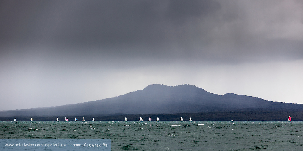 Winters yacht race along a partially rain covered Rangitoto Island.
