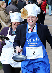 MP Sarah Wollaston and Lord Redesdale take part in the Parliamentary Pancake Race held in Westminster,  London, Tuesday, 4th March 2014. Picture by Stephen Lock / i-Images