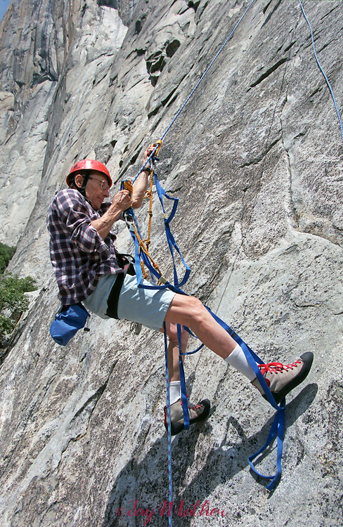 Gerry Bloch, 81, became the oldest climber to scale El Capitan.  He was guided by Mike Corbett on the Aquarian Wall.  Bloch was practicing on a lower section of the cliff before the climb.  May 5, 1999.