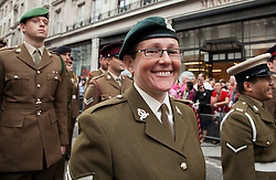 © Licensed to London News Pictures. LONDON, UK  02/07/11. A female member of the British Army smiles as she takes part in London's Pride March. 21 floats and around a million people flocked to Central London for the festival which celebrates the diversity within the LBGT (lesbian, gay, bisexual and transgender) community.  Please see special instructions for usage rates. Photo credit should read Matt Cetti-Roberts/LNP