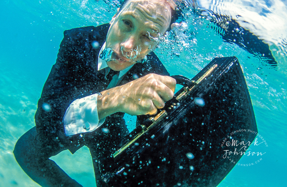 Australia, Queensland, businessman underwater with briefcase.  MR available.