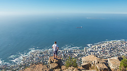 Hiker overlooking Clifton beaches from Lions Head, Cape Town, South Africa. 08/01/15. Photo by Andrew Tallon