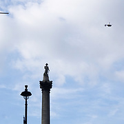 Police helicopter hovering on top of nelson's column aftermath Tuesday's knife attack on Westminster Bridge and in the grounds of Parliament, in which three people and their attacker were killed with over 40 injured on 23th March 2017, Trafalgar square,London,UK. See Li