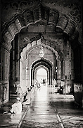 Men line up for morning prayers at Jama Majid in New Delhi, India. Black and White.