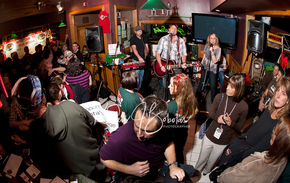 Pub Mania was in full swing at Patricks Pub and Eatery with the Eric Grant Band on stage Thursday evening entertaining the crowd of culinary athletes/teams and supporters that came out to benefit the WLNH Children's Auction.   (Karen Bobotas/for the Laconia Daily Sun)
