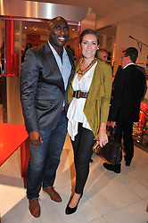 SOL CAMPBELL and his wife FIONA BARRATT at an exhibition at The Conran Shop entitled Red to celebrate 25 years of The Conran Shop at the Michelin Building, 81 Fulham Road, London on 19th September 2012.