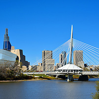 """Winnipeg Skyline along Red River, Canada<br /> Welcome to Winnipeg, the capital of Manitoba, Canada. Come explore the history that dates back 6,000 years. The city has grown into the country's seventh largest. You will find lush parks, converging rivers, professional sports, cultural venues, polar bears, stunning architecture, beautiful murals, a vibrant economy and 750,000 people who are proud of the """"Gateway to the West."""""""