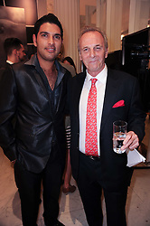 Left to right, Indian Cricket star YUVRAJ SINGH and MARK SHAND at Emerald for Elephants exhibition held at Selfridge's, Oxford Street, London on 23rd June 2010.